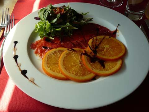 Carpaccio de canard et ses minis oranges d'or confites saladines